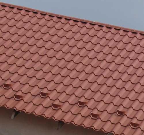 Стоимость покрытия крыши металлочерепицей